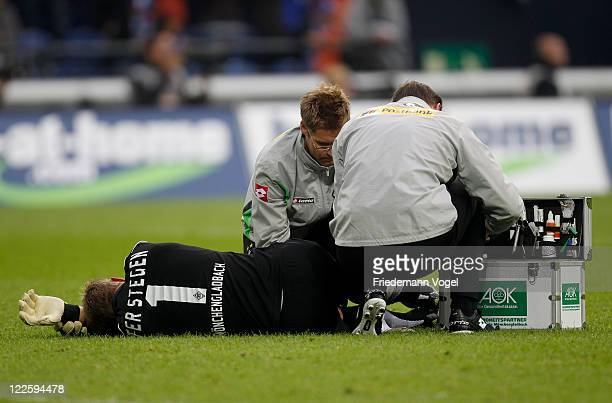 MarcAndre ter Stegen of Moenchengladbach lies injured on pitch during the Bundesliga match between FC Schalke 04 and Borussia Moenchengladbach at...