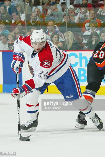 MarcAndre Thinel of the Hamilton Bulldogs controls the puck on his backhand during the American Hockey League game against the Philadelphia Phantoms...