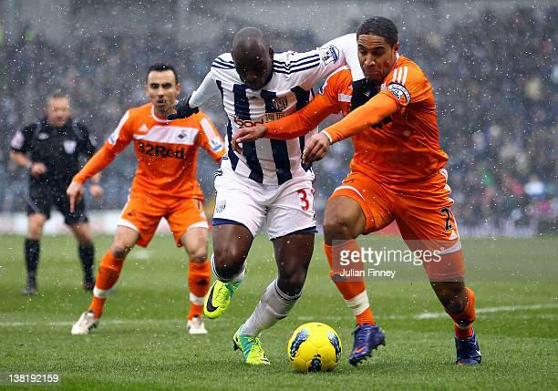 MarcAntoine Fortune of West Brom battles with Ashley Williams of Swansea during the Barclays Premier League match between West Bromwich Albion and...