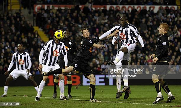 MarcAntoine Fortune scores the second goal for West Brom during the Barclays Premier League match between West Bromwich Albion and Wigan Athletic at...