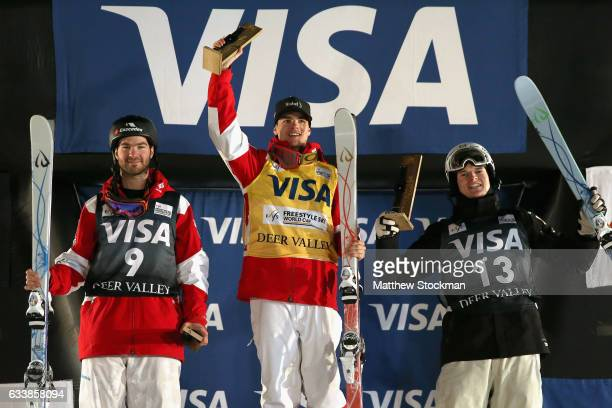 MarcAntoine Gagnon of Canada Mikael Kingsbury of Canada and Brodie Summers of Australia celebrate on the medals podium after the Men's Dual Moguls...