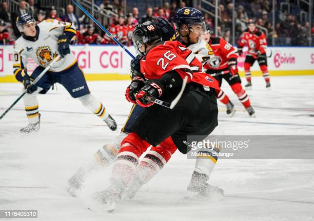 Marc-Antoine Pepin of the Shawinigan Cataractes and Thomas Caron of the Quebec Remparts collide during their QMJHL hockey game at the Videotron...
