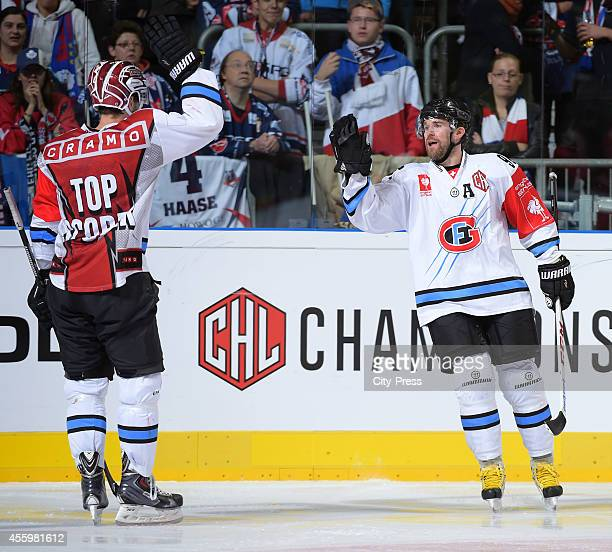 MarcAntoine Pouliot and Christian Dube of HC FribourgGottero celebrate after scoring the 20 during the Champions Hockey League group stage game...