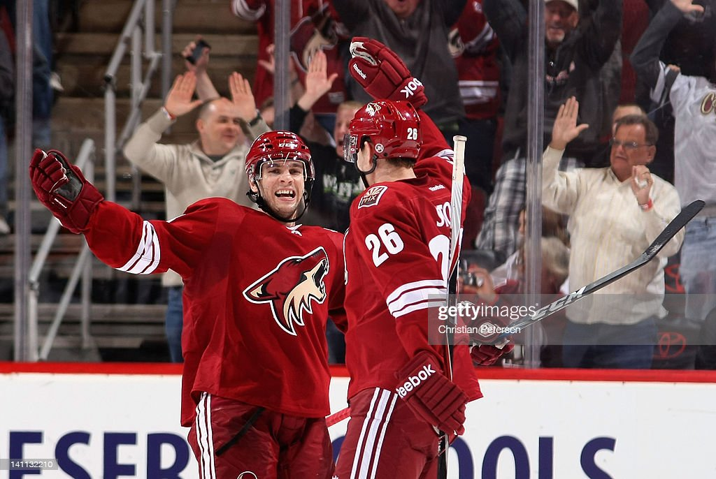 Marc-Antoine Pouliot #43 and Michael Stone #26 of the Phoenix Coyotes celebrate after Stone scored a second period goal against the San Jose Sharks during the NHL game at Jobing.com Arena on March 10, 2012 in Glendale, Arizona. The Coyotes defeated the Sharks 3-0.