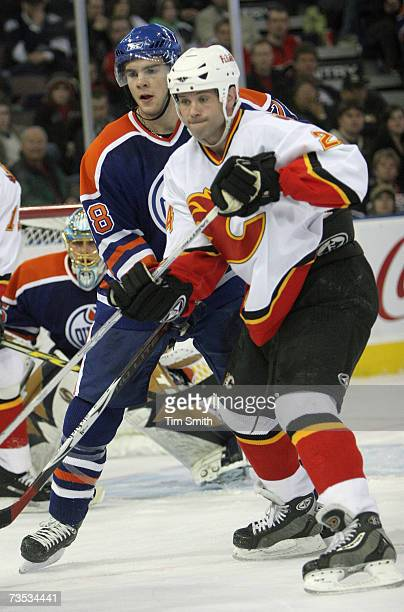 MarcAntoine Pouliot of the Edmonton Oilers defends against Craig Conroy of the Calgary Flames at Rexall Place on March 3 2007 in Edmonton Alberta...