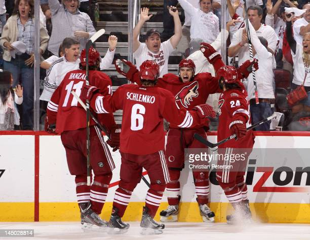 MarcAntoine Pouliot of the Phoenix Coyotes celebrates his second period goal with teammates Martin Hanzal David Schlemko and Kyle Chipchura against...