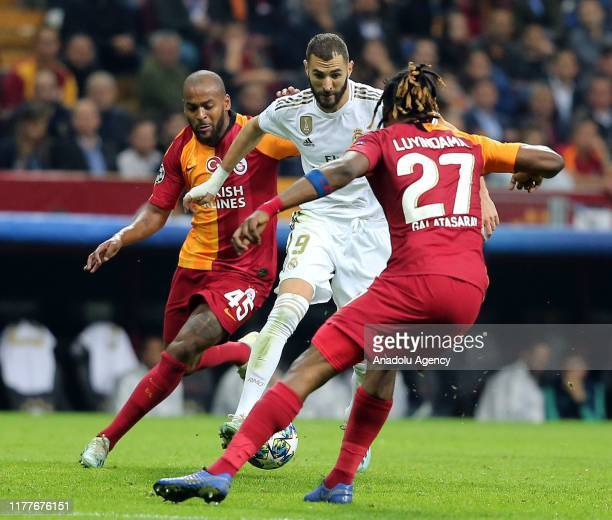 Marcao and Luyindama of Galatasaray in action against Benzama of Real Madrid during the UEFA Champions League Group A match between Galatasaray and...