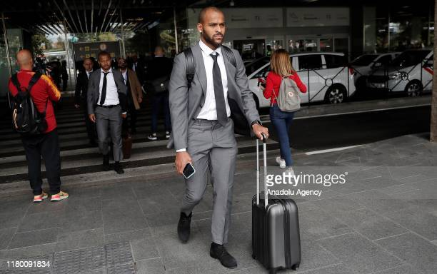 Marcao and Mariano of Galatasaray carry their luggages as the team arrives at Barajas Airport ahead of the UEFA Champions League Group A soccer match...