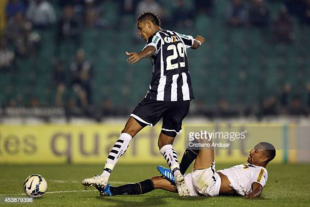 Marcao of Figueirense battles for the ball with Airton of Botafogo during a match between Figueirense and Botafogo as part of Campeonato Brasileiro...