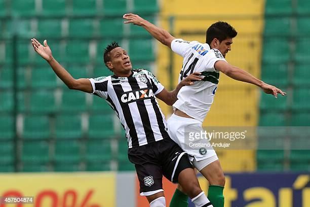 Marcao of Figueirense battles with Leandro Almeida of Coritiba during a match between Figueirense and Coritiba as part of Campeonato Brasileiro 2014...