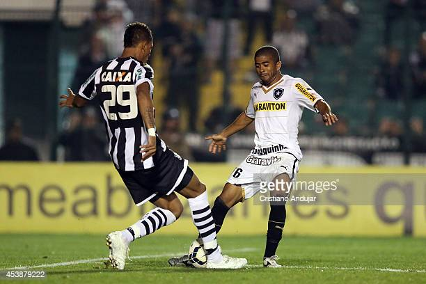 Marcao of Figueirense fight for the ball with Junior Cesar of Botafogo during a match between Figueirense and Botafogo as part of Campeonato...