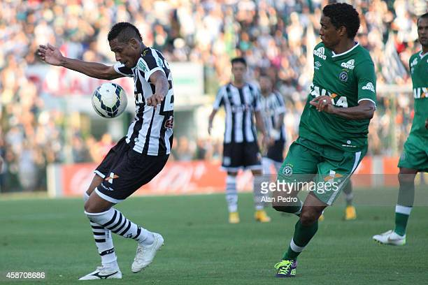 Marcao of Figueirense struggles for the ball with Rafael Lima of Chapecoense during a match between Figueirense and Chapecoense for the Brazilian...