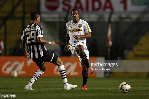 Marcao of Figueirense thy to take the ball with Andre Bahia of Botafogo during a match between Figueirense and Botafogo as part of Campeonato...