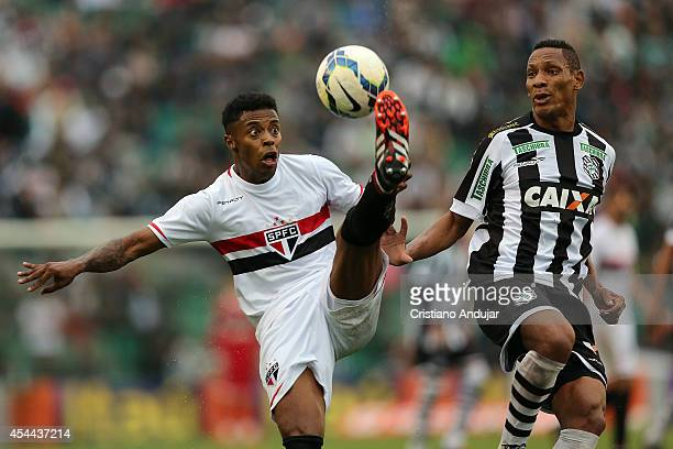 Marcao of Figueirense try to take the ball of Michel Bastos of Sao Paulo during a match between Figueirense and Sao Paulo as part of Campeonato...