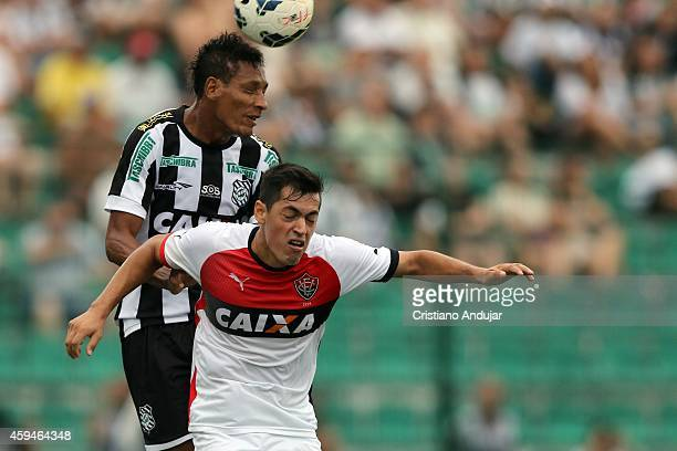 Marcao of Figueirense wins header with Caceres of Vitoria during a match between Figueirense and Vitoria as part of Campeonato Brasileiro 2014 at...