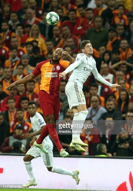 Marcao of Galatasaray and Federico Valverde of Real Madrid vie for the ball during the UEFA Champions League Group A match between Galatasaray and...