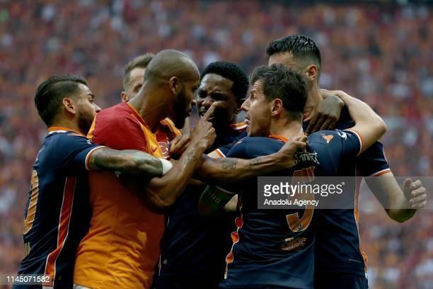 Marcao of Galatasaray argues with Emre Belozoglu of Medipol Basaksehir during Turkish Super Lig match between Galatasaray and Medipol Basaksehir at...