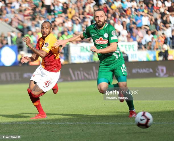 Marcao of Galatasaray in action against Vedat Muric of Caykur Rizespor during the Turkish Super Lig soccer match between Caykur Rizespor and...