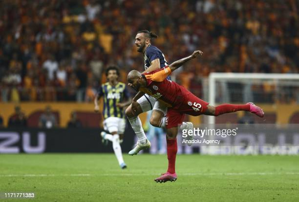 Marcao of Galatasaray in action against Vedat Muriqi of Fenerbahce during the Turkish Super Lig soccer match between Galatasaray and Fenerbahce at...
