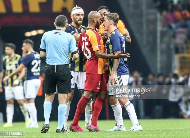 Marcao of Galatasaray in argue with Max Kruse of Fenerbahce during the Turkish Super Lig soccer match between Galatasaray and Fenerbahce at the Turk...