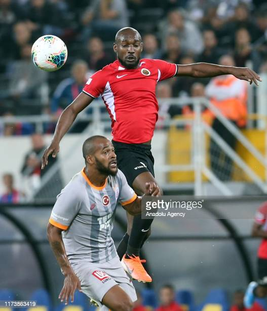 Marcao of Galatasaray vies for the ball against Giovanni Sio during the Turkish Super Lig soccer match between Genclerbirligi and Galatasaray at the...