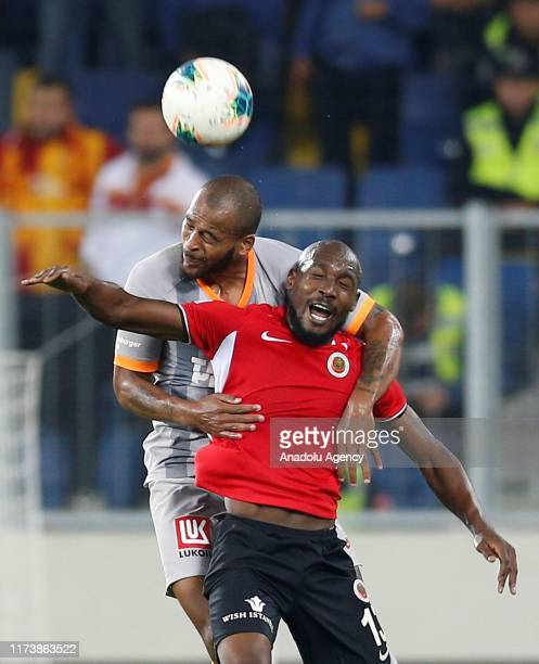 Marcao of Galatasaray vies for the ball against Guy Yann Sio of Genclerbirligi during the Turkish Super Lig soccer match between Genclerbirligi and...