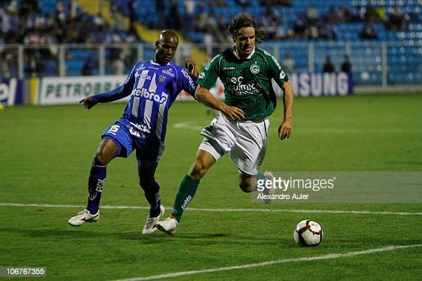 Marcao of Goias struggles for the ball with Rudinei of Avai during a match as part of the 2010 Copa Nissan Sudamericana at Ressacada stadium on...