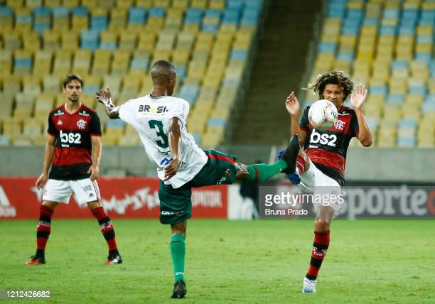 Marcao of Portuguesa and Willian Arao of Flamengo fight for the ball during a match between Flamengo and Potuguesa as part of the Rio State...