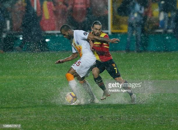 Marcao Teixeira of Galatasaray in action against Halil Akbunar of Goztepe during the Turkish Super Lig soccer match between Goztepe and Galatasaray...