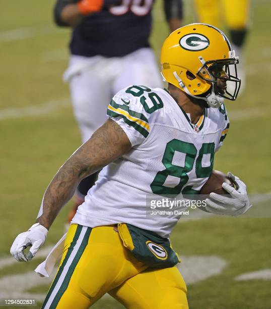 Marcedes Lewis of the Green Bay Packers runs after a catch against the Chicago Bears at Soldier Field on January 03, 2021 in Chicago, Illinois. The...