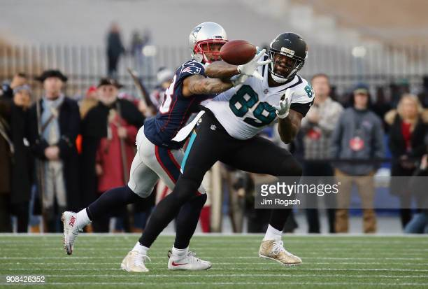 Marcedes Lewis of the Jacksonville Jaguars catches a pass as he is defended by Patrick Chung of the New England Patriots in the second quarter during...