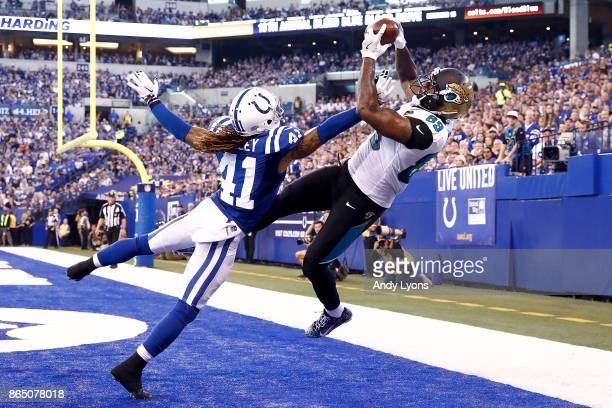 Marcedes Lewis of the Jacksonville Jaguars catches a pass in the endzone for a touchdown defended by Matthias Farley of the Indianapolis Colts during...