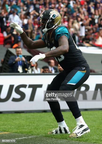 Marcedes Lewis of the Jacksonville Jaguars celebrates after scoring a touchdown during the NFL International Series match between Baltimore Ravens...