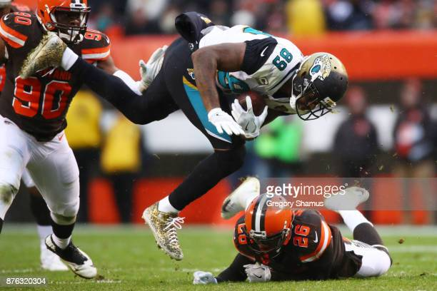 Marcedes Lewis of the Jacksonville Jaguars flips over Derrick Kindred of the Cleveland Browns in the first half at FirstEnergy Stadium on November 19...