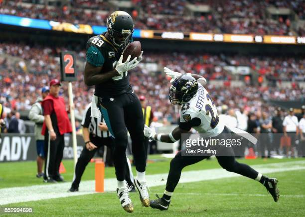 Marcedes Lewis of the Jacksonville Jaguars scores a touchdown during the NFL International Series match between Baltimore Ravens and Jacksonville...