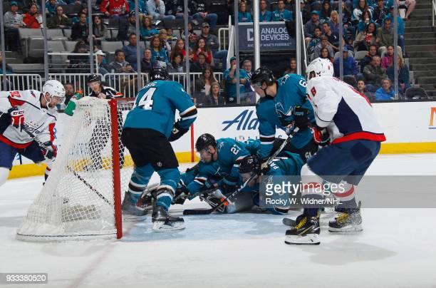 MarcEdouard Vlasic Joonas Donskoi and Joe Pavelski of the San Jose Sharks defend the net against the Washington Capitals at SAP Center on March 10...