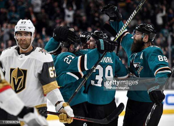 MarcEdouard Vlasic Joonas Donskoi Logan Couture and Brent Burns of the San Jose Sharks celebrate scoring a goal against the Vegas Golden Knights at...
