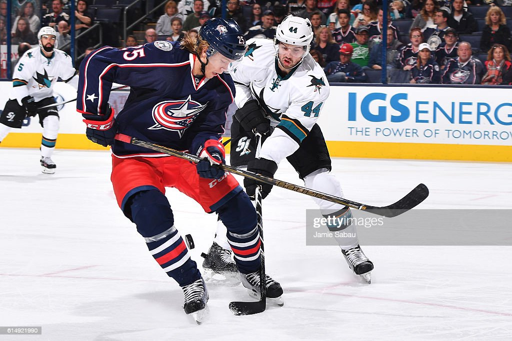 Marc-Edouard Vlasic #44 of the San Jose Sharks attempts to knock the puck away from William Karlsson #25 of the Columbus Blue Jackets during the third period of a game on October 15, 2016 at Nationwide Arena in Columbus, Ohio. San Jose defeated Columbus 3-2.