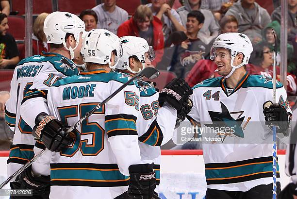MarcEdouard Vlasic of the San Jose Sharks celebrates with Brad Winchester Mike Moore and Andrew Desjardins after Vlasic scored a third period goal...