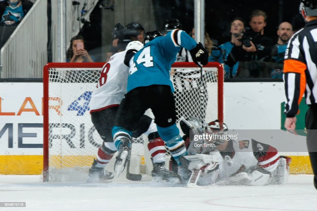Marc-Edouard Vlasic #44 of the San Jose Sharks gets the puck by Scott Wedgewood #31 of the Arizona Coyotes to score in OT at SAP Center on January 13, 2018 in San Jose, California.