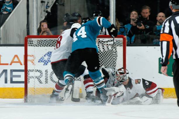 Marc-Edouard Vlasic  44 of the San Jose Sharks gets the puck by Scott 6dbc3dbe4