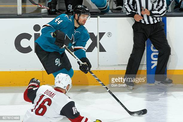 Marc-Edouard Vlasic of the San Jose Sharks handles the puck during a NHL game against the Arizona Coyotes at SAP Center at San Jose on November 29,...
