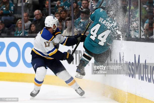 Marc-Edouard Vlasic of the San Jose Sharks hits the glass in front of Jaden Schwartz of the St. Louis Blues in Game Two of the Western Conference...