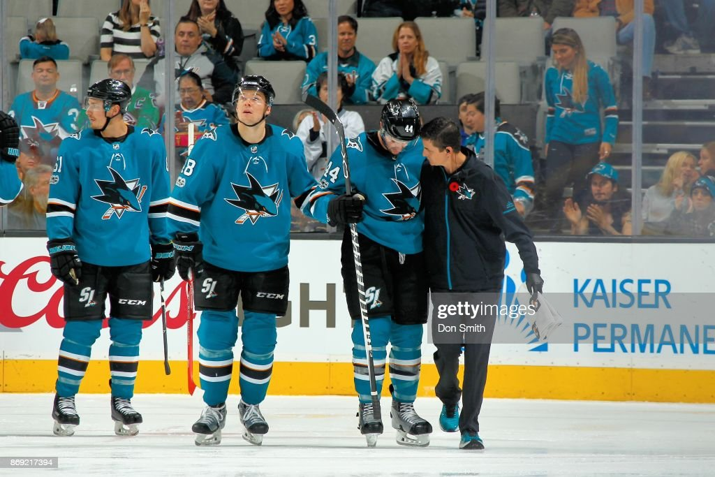 Marc-Edouard Vlasic #44 of the San Jose Sharks is assisted off the ice by Head athletic trainer, Ray Tufts after getting boarded by Ryan Johansen #92 of the Nashville Predators at SAP Center on November 1, 2017 in San Jose, California.