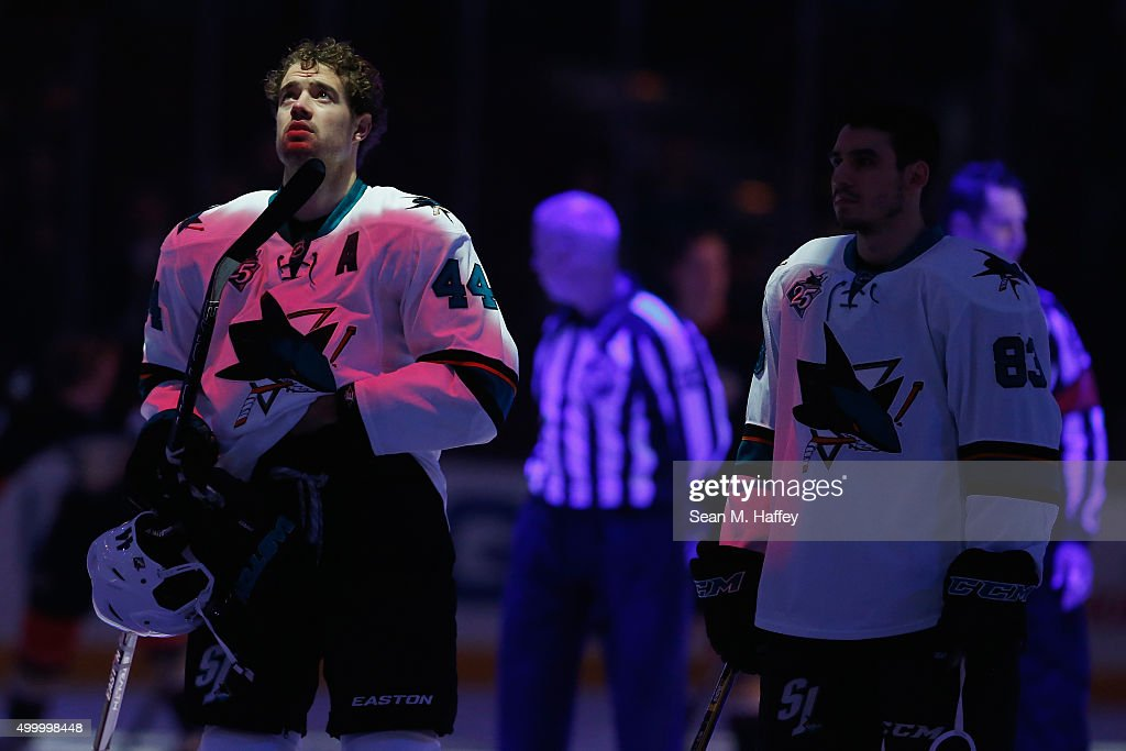 Marc-Edouard Vlasic #44 of the San Jose Sharks looks into the light during the national anthem prior to a game against the Anaheim Ducks at Honda Center on December 4, 2015 in Anaheim, California.