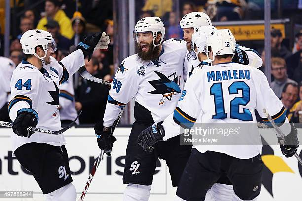 MarcEdouard Vlasic of the San Jose Sharks Patrick Marleau and Brent Burns celebrate with Joe Thornton after he scored against the Boston Bruins...