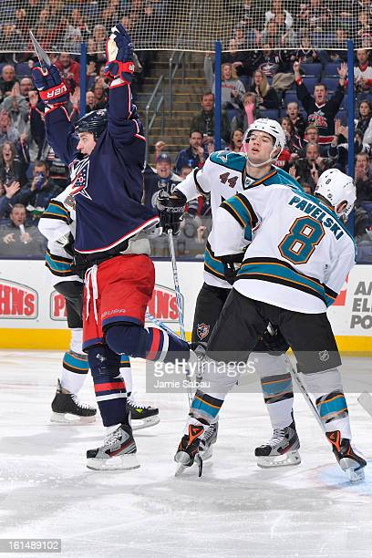 MarcEdouard Vlasic of the San Jose Sharks reacts as Brandon Dubinsky of the Columbus Blue Jackets celebrates after scoring a goal during the first...