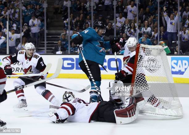 MarcEdouard Vlasic of the San Jose Sharks scores the winning goal on Christian Dvorak and Scott Wedgewood of the Arizona Coyotes in overtime at SAP...