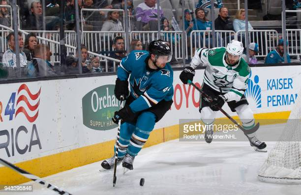 MarcEdouard Vlasic of the San Jose Sharks skates with the puck against Alexander Radulov of the Dallas Stars at SAP Center on April 3 2018 in San...