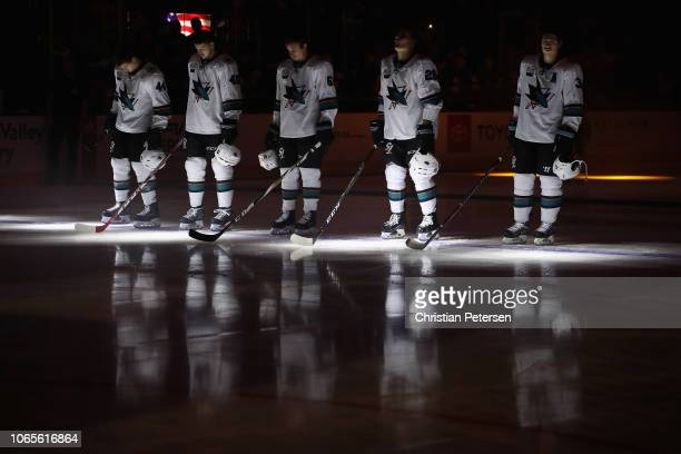 MarcEdouard Vlasic Tomas Hertl Justin Braun Timo Meier and Logan Couture of the San Jose Sharks stand for the national anthem before the NHL game...